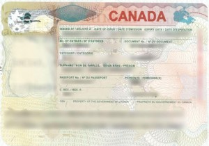 Temporary resident visas (TRV)s are about the size of a passport page and placed in the passport by Canadian immigration officials.