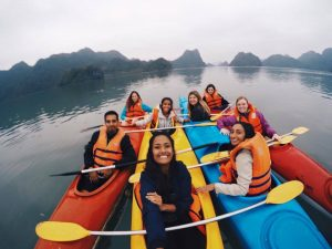 eight people in their Kayak on the sea