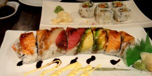 variety of sushi on a flat plate