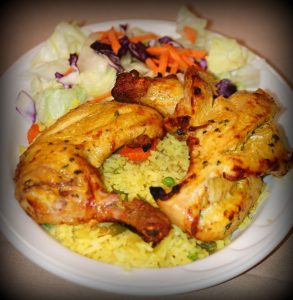 rice with chicken legs and garnished with lettuce and carrots